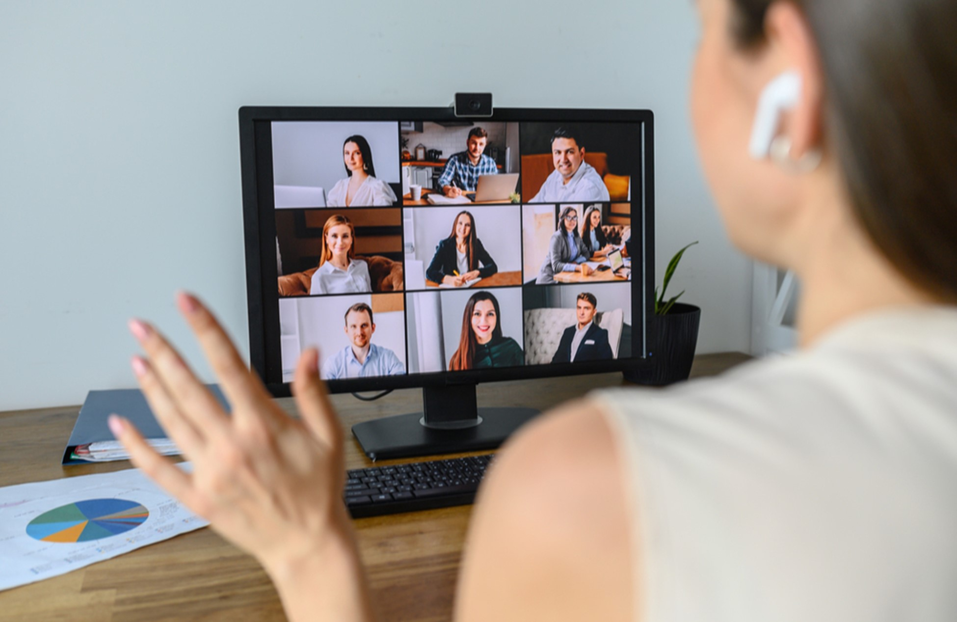 A woman communicating with coworkers in a virtual meeting