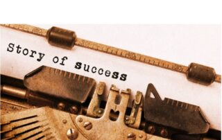 Typewriter with the words story of success